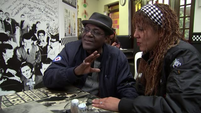 coventry named as next uk city of culture coventry int neville staple setup shots with reporter / interview sot buses along street int high angle... - coventry stock videos & royalty-free footage
