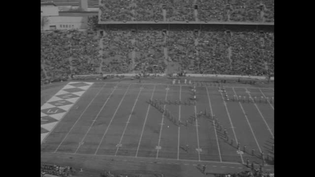 cover of program booklet for 1953 cotton bowl classic between texas longhorns and tennessee volunteers / pan cotton bowl stadium in dallas tx with... - university of tennessee stock videos and b-roll footage