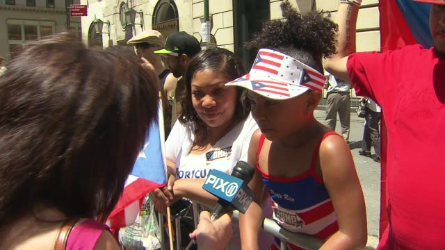 coverage of the 57th annual puerto rican day parade on 5th avenue in new york city among spectators guests of honor included grand marshals... - puerto rican ethnicity stock videos & royalty-free footage