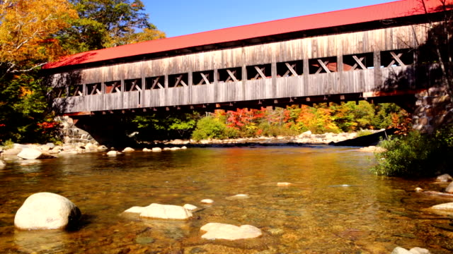 covered bridge, river and fall foliage, swift river, nh, usa - new hampshire stock videos & royalty-free footage