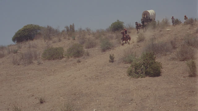 covered wagons down hill (albertson's) - cowboy stock videos & royalty-free footage