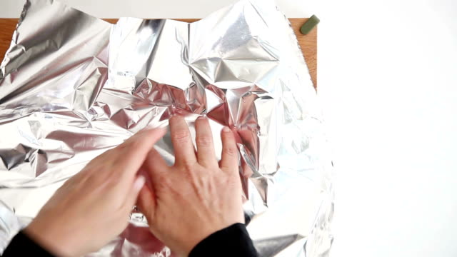 covering a pot with aluminum foil - aluminium stock videos & royalty-free footage