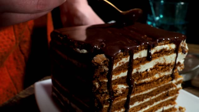Covering homemade cake with chocolate coating