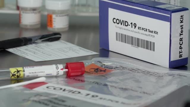 covid- 19 coronavirus test kit in medical lab - testing kit stock videos & royalty-free footage