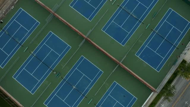 vídeos y material grabado en eventos de stock de covid 19 shelter at home - empty tennis courts and baseball field - refugiarse en un lugar concepto
