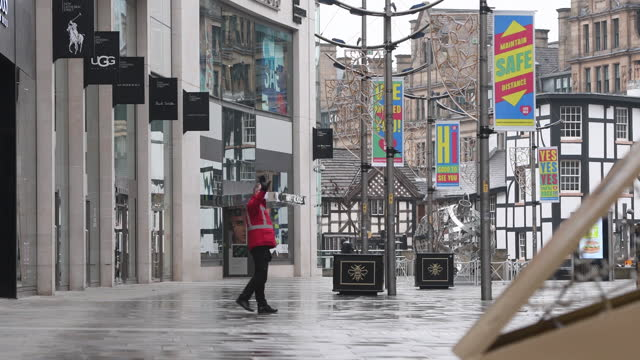 covid signage displayed on empty street as manchester is hit with tougher lockdown despite vaccines, in manchester, united kingdom, on thursday,... - high street stock videos & royalty-free footage