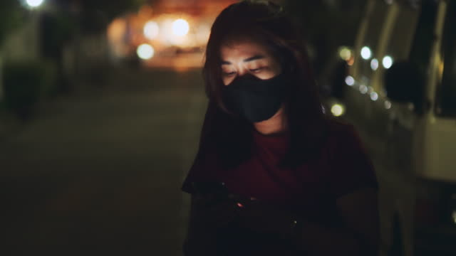 covid-19  : asian woman using smart phone at night. - low unemployment stock videos & royalty-free footage
