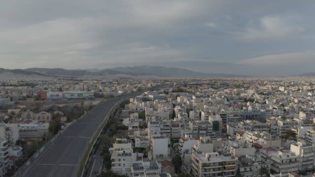 covid-19 athens greece quarantine prores raw log aerial footage of empty avenues, hubs and highways - athens greece video stock e b–roll