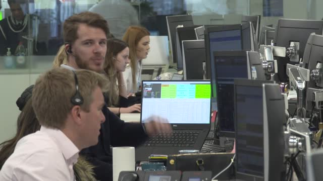 market trading floor gvs; england: city of london: cannon bridge house: ig: int various shots of traders viewing shares on computer screens and in... - market stock videos & royalty-free footage