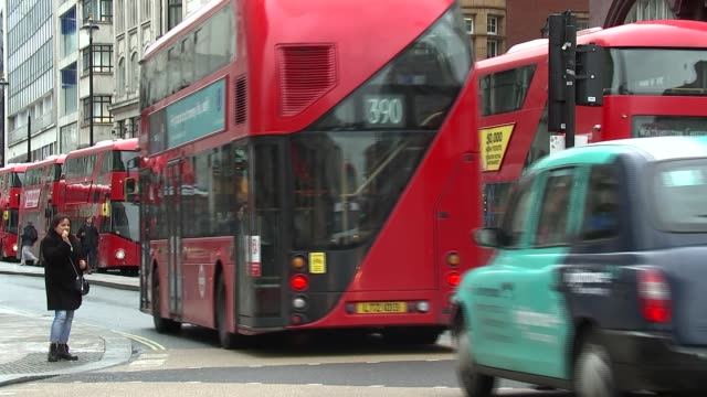 people and traffic along at oxford circus england london oxford circus ext buses turning / buses queued at traffic lights / various of people along... - bus stock videos & royalty-free footage