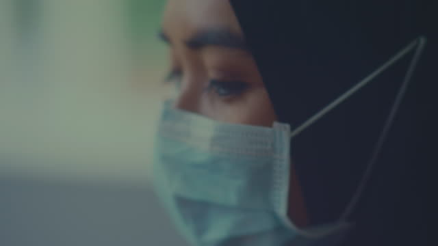 covid-19 effect : arab woman with face mask - religious celebration stock videos & royalty-free footage