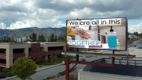 covid-19 handwashing billboard - dogota; composite. - b roll stock videos & royalty-free footage