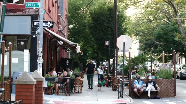 covid-19 pandemic. brooklyn, nyc. social distancing outdoor dining & leisure. - dining stock videos & royalty-free footage