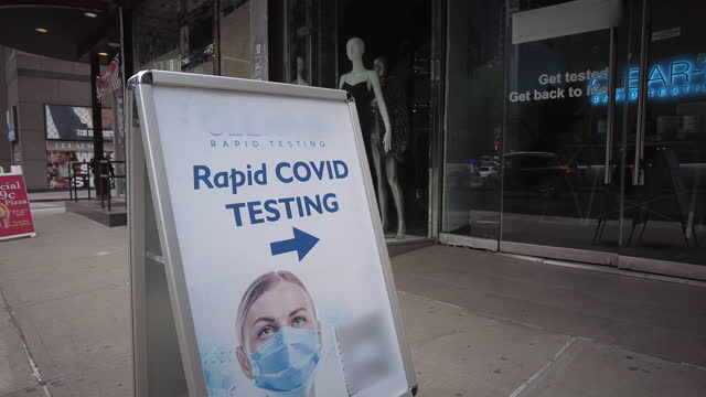 covid-19 rapid testing site in midtown manhattan near times square. camera focuses on advertisement in front of the testing site. - arrow symbol stock videos & royalty-free footage