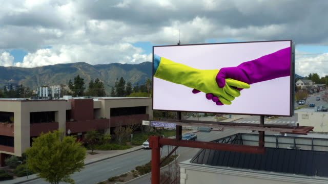 covid-19- rubber gloves shaking hands - billboard stock videos & royalty-free footage