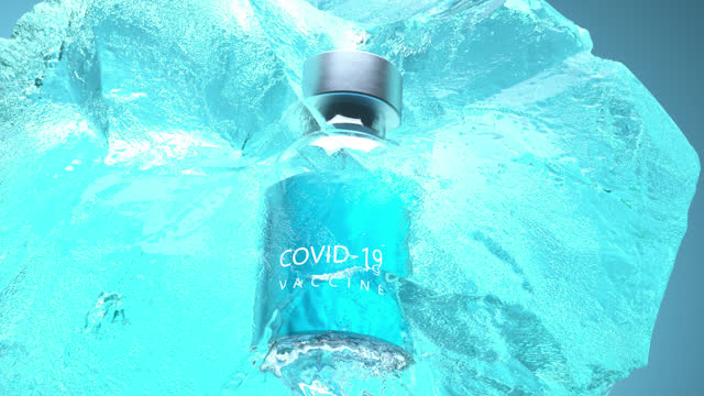 covid-19 vaccine bottle inside ice - ice stock videos & royalty-free footage