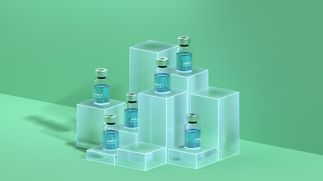 covid-19 vaccine bottles on cubes - variation bildbanksvideor och videomaterial från bakom kulisserna