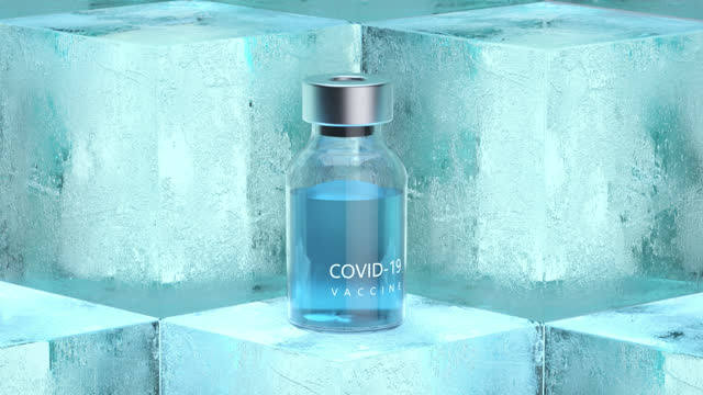 covid-19 vaccine bottles on ice cubes. - frozen stock videos & royalty-free footage