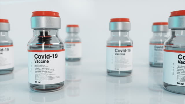 covid-19 vaccine vial, slide - medical research stock videos & royalty-free footage