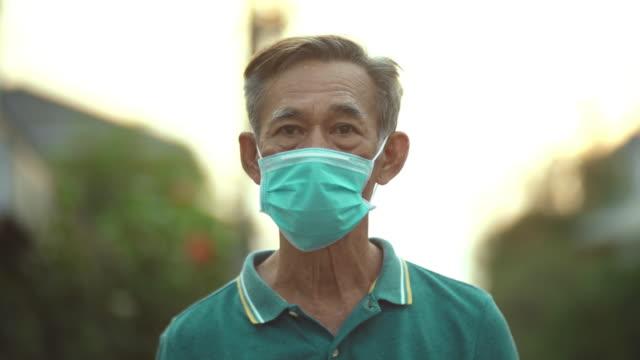 covid-19 virus protection , asian senior man - asian man coughing stock videos & royalty-free footage