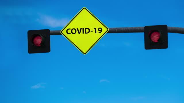 covid-19 virus street light animation - street name sign stock videos & royalty-free footage
