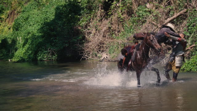 cowboy and man fighting in the river - cowboy ranch stock videos & royalty-free footage