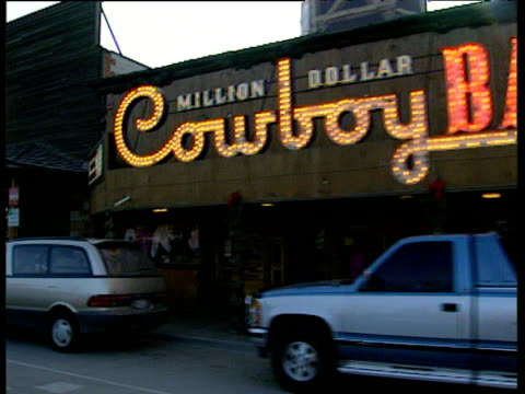 cowboy bar signs pickup trucks and wyoming license plate on truck - jackson hole stock-videos und b-roll-filmmaterial
