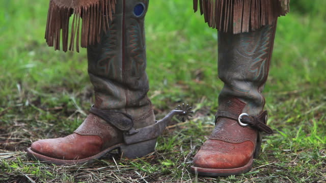 cowboy boots, spurs, chaps and horse eating - appaloosa stock videos and b-roll footage