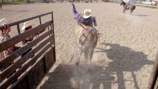cowboy bull riding - bucking stock videos & royalty-free footage