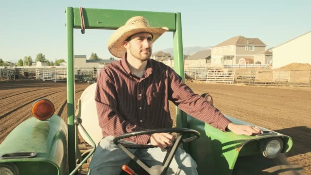 Cowboy Driving a Tractor