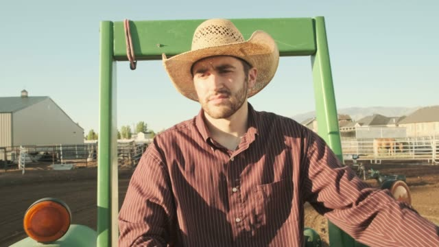 cowboy driving a tractor - rancher stock videos & royalty-free footage