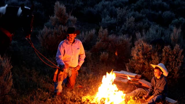 cowboy family campfire cookout - ranch family stock videos & royalty-free footage