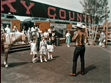 cowboy lassoing little girl at new york world's fair exhibit/ queens, ny - new york world's fair stock videos & royalty-free footage