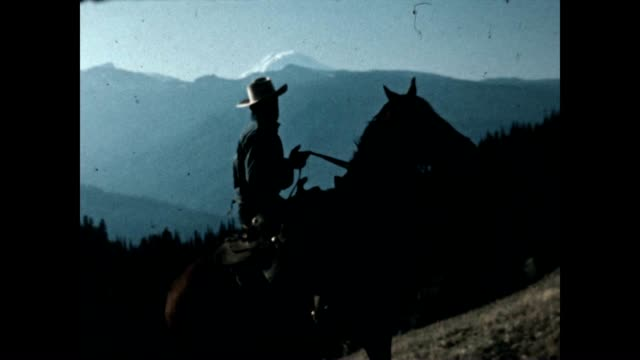 cowboy on horse looks at mount rainier in this archival film. - mt rainier stock videos & royalty-free footage