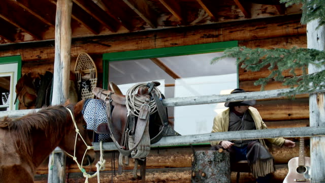 cowboy plays his guitar on porch of the cabin - front porch stock videos and b-roll footage