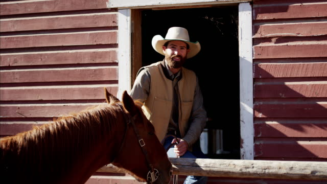 Cowboy Ranch hand with horse Dude Ranch USA