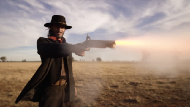 cowboy shoots gun - schurke stock-videos und b-roll-filmmaterial