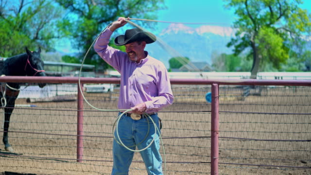 cowboy training lassoing on a ranch - rodeo stock videos & royalty-free footage