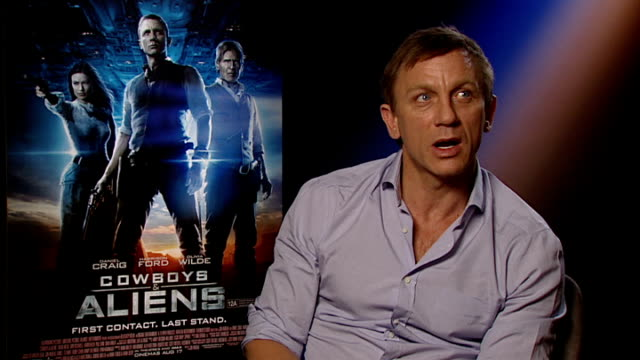 vídeos de stock, filmes e b-roll de cast interviews england london int daniel craig interview sot always wanted to be a cowboy still do on making the film world cup was on so at... - daniel craig ator