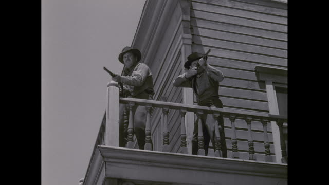 WS Cowboys firing shotguns on balcony / United States