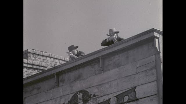 WS Cowboys firing shotguns on terrace / United States