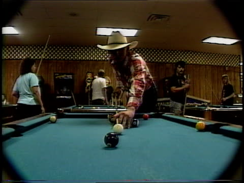cowboys playing pool in pool hall in missouri - cappello da cowboy video stock e b–roll