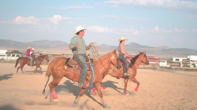 cowboys riding horse at a rodeo