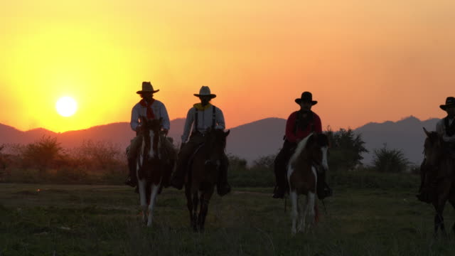 cowboys with revolver riding horses - rodeo stock videos & royalty-free footage