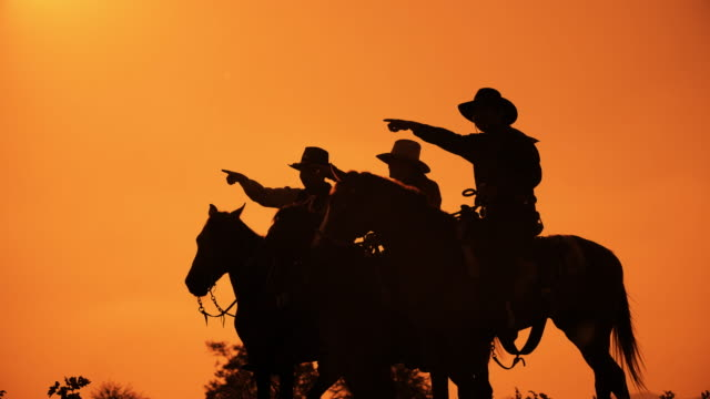 cowboys with revolver riding horses - cowboy stock videos & royalty-free footage