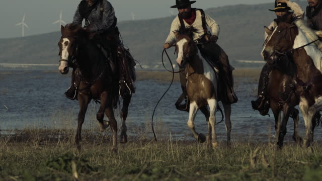 cowboys with revolver riding horses - cowboy ranch stock videos & royalty-free footage