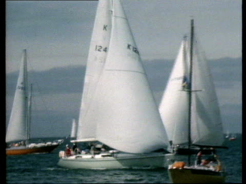 isle of wight cowes boats lr including yermah 22 pan lr prince phillip at wheel waves video sotv archive tape 4981 tx'd 06/08/79 nao - isle of wight stock videos and b-roll footage