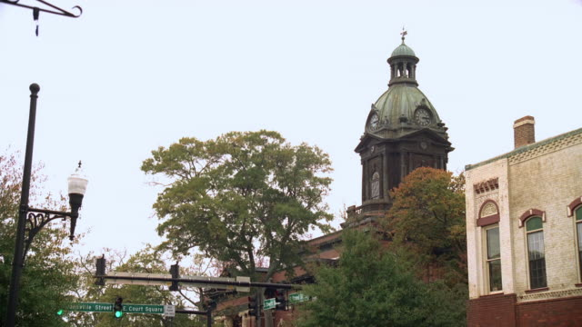la coweta county courthouse steeple above main street buildings / newnan, georgia, united states - steeple stock videos & royalty-free footage
