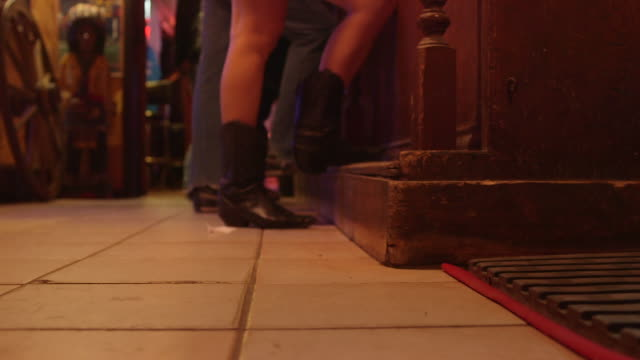 cowgirl at the bar - country and western stock videos & royalty-free footage
