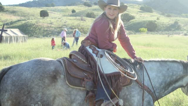 cowgirl horseback ride in the country - recreational horse riding stock videos and b-roll footage